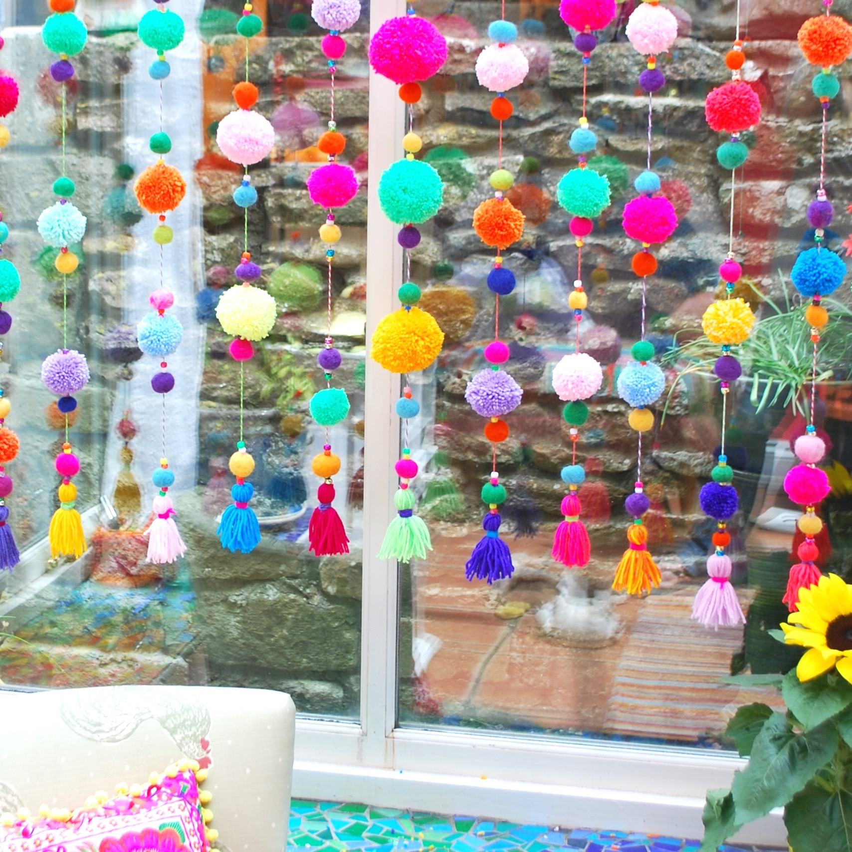 Colourful tassels on a pom pom curtain