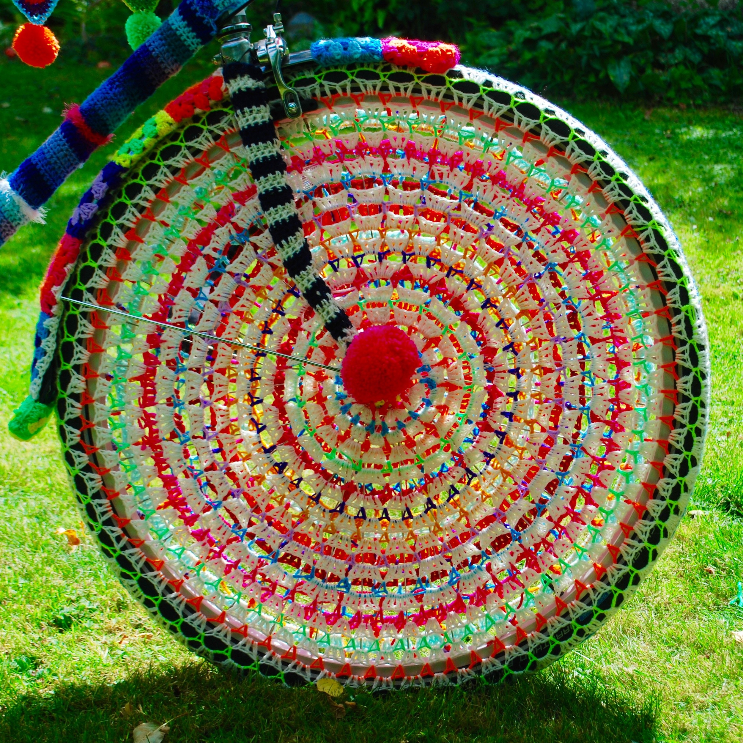 One side (white) of the crochet wheel for the yarn bomb bike by Emma Leith
