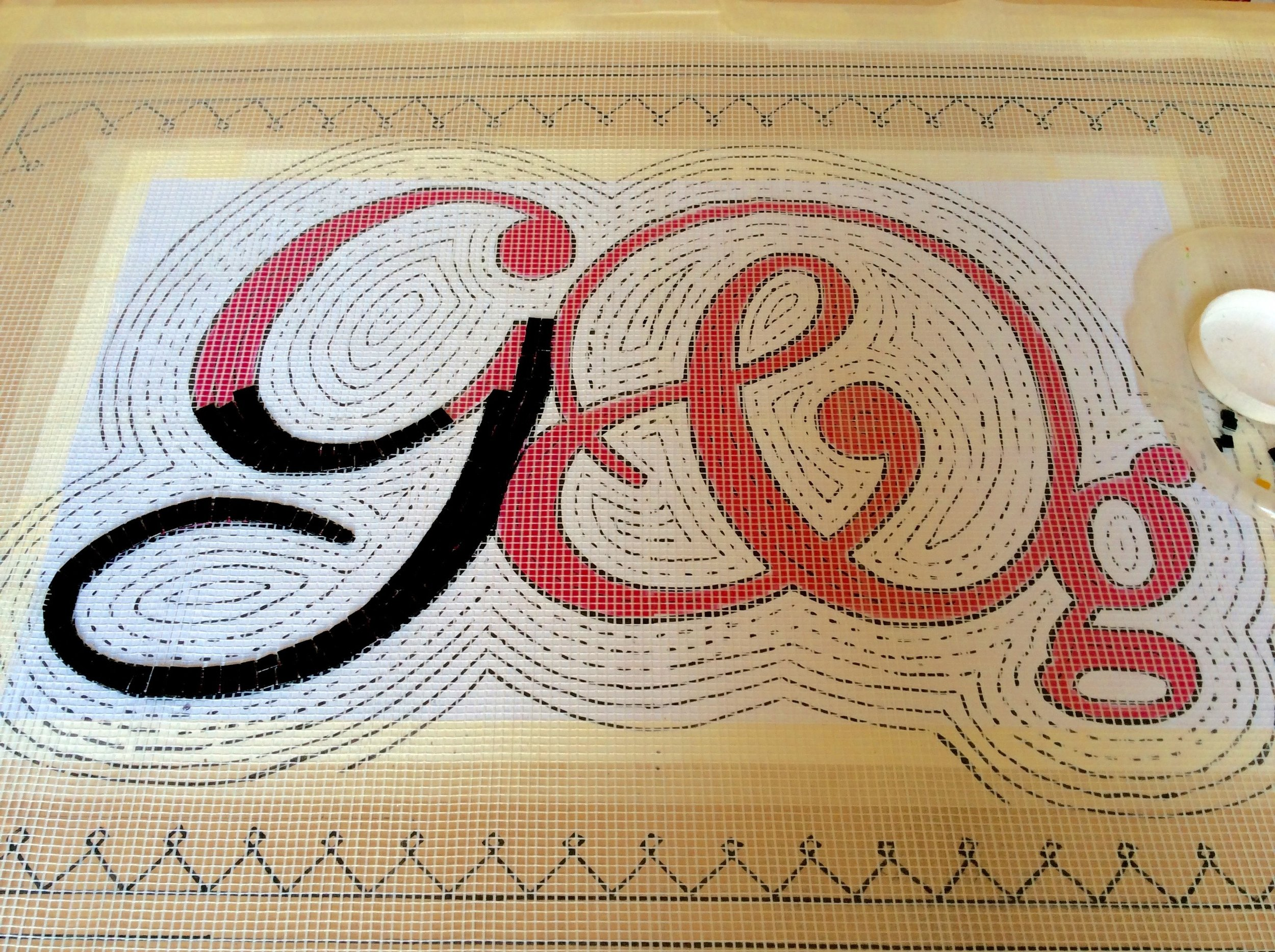 Making a mosaic on mesh.  Graham and Green shop doorway mosaic