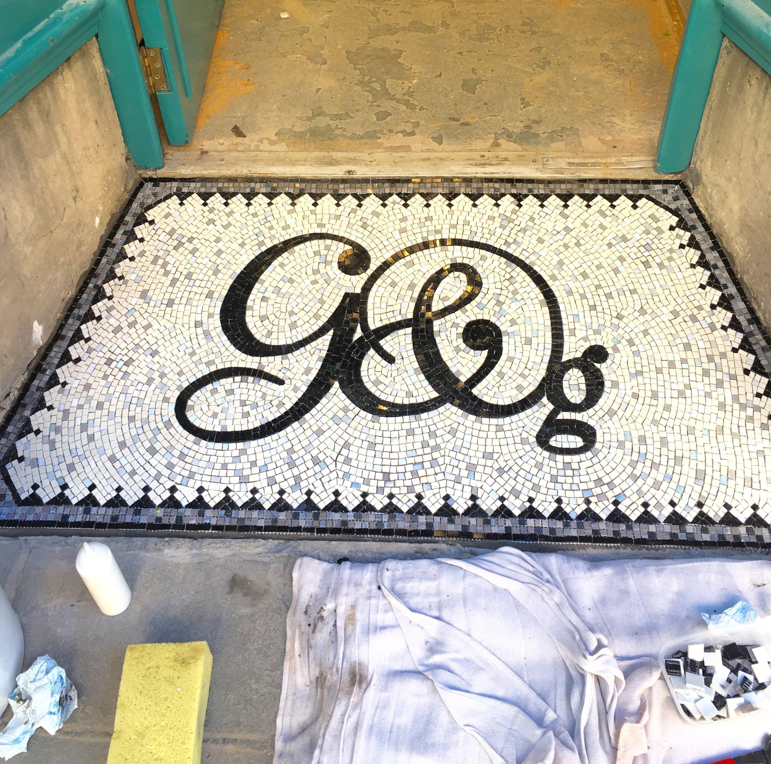 Making a mosaic on mesh. Graham and Green Bath shop doorway mosaic.