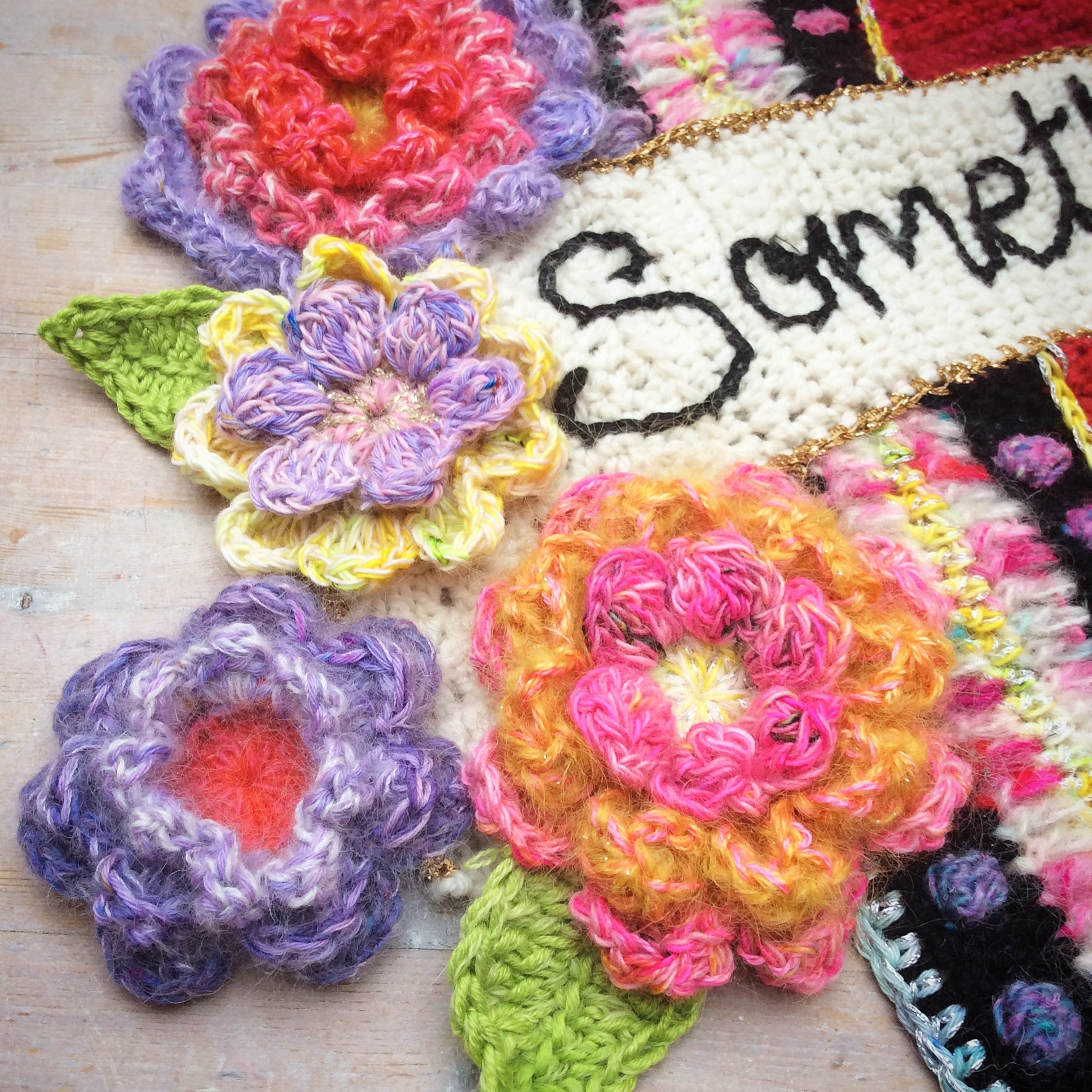Large oversize crochet flowers detail of crochet art piece by crochet artist Emma Leith