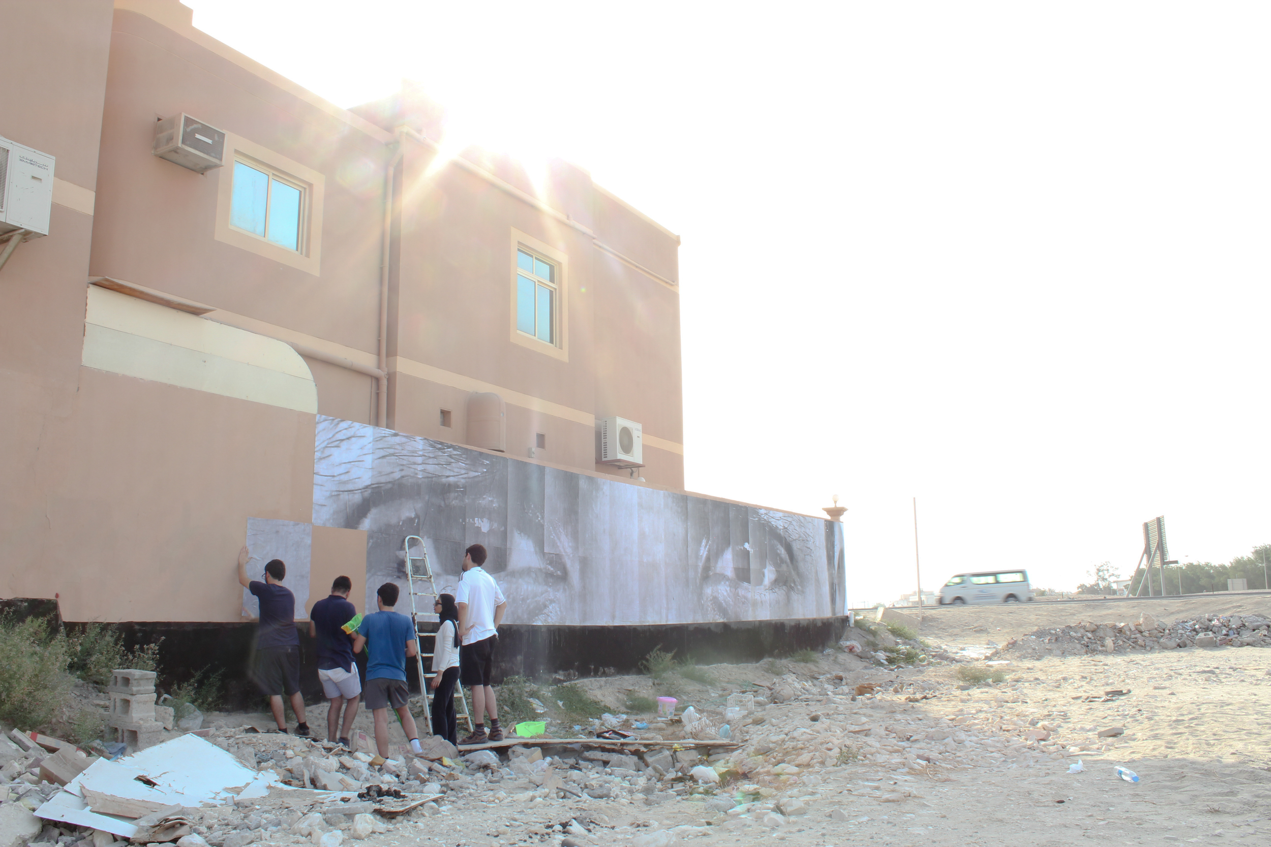Silver Cord Team working on their mural in A'ali