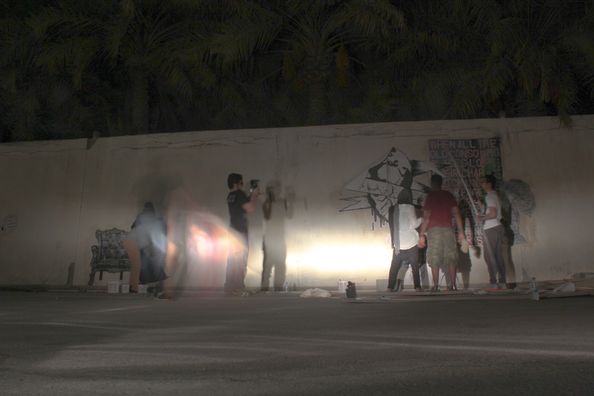 """The """"paste it"""" group working on their collective mural"""