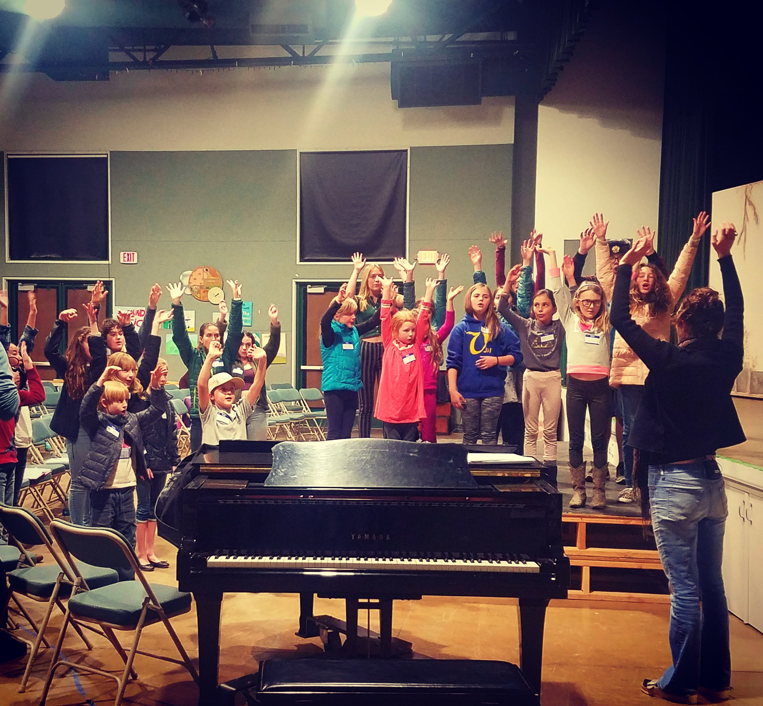 OYO Artistic Director Rebecca Comerford leading her young cast in vocal warmups at their first rehearsal.