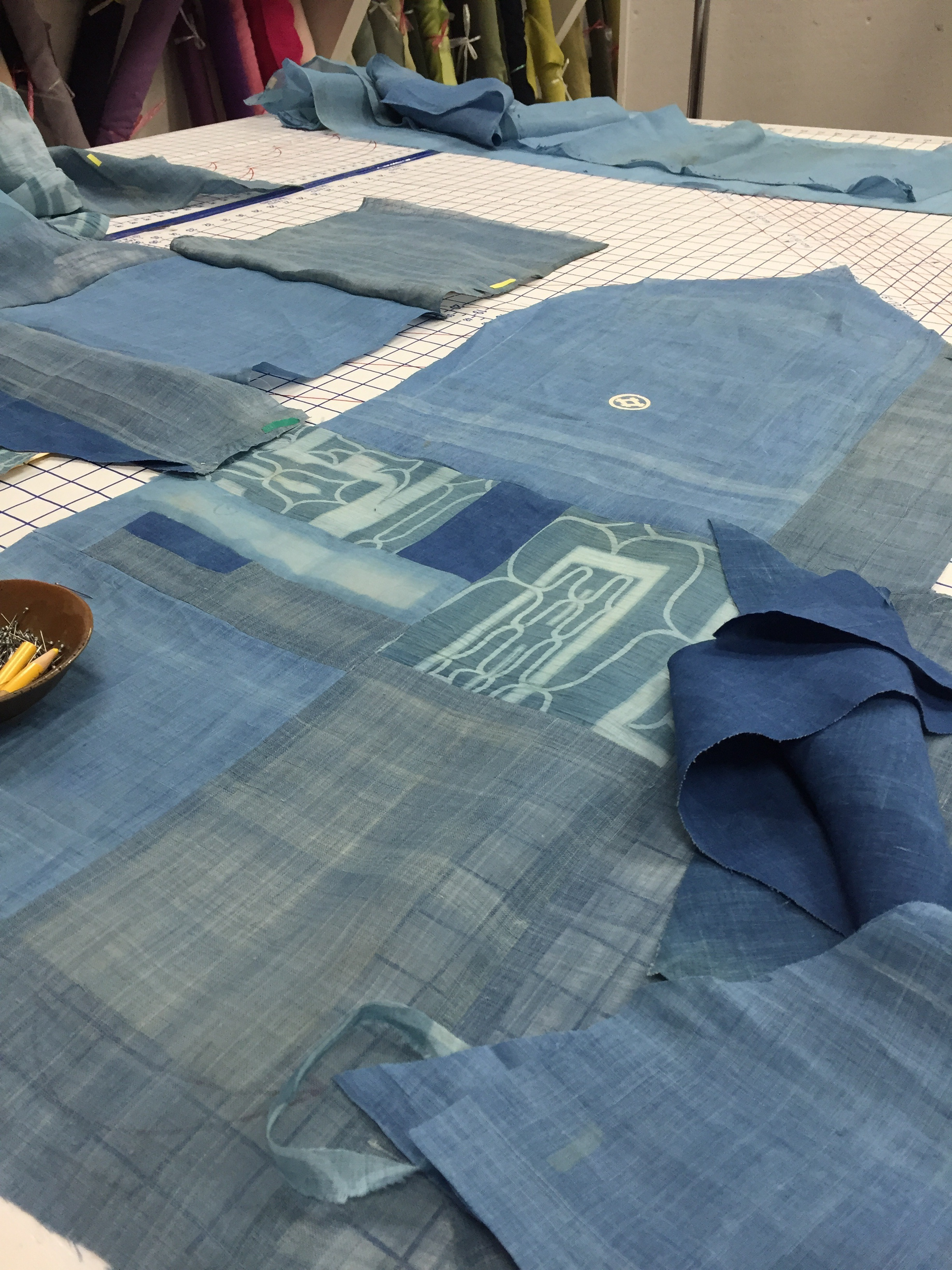 Linen patchwork being laid out on Sarah's table.