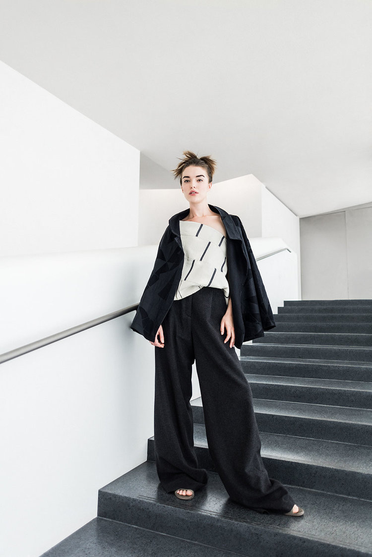 Walking Jacket in mola cloth created in-house in baby camel hair and linen; Dosa Indian cotton scarf worn as one-shoulder top; Wide-Leg Pant in Italian cashmere