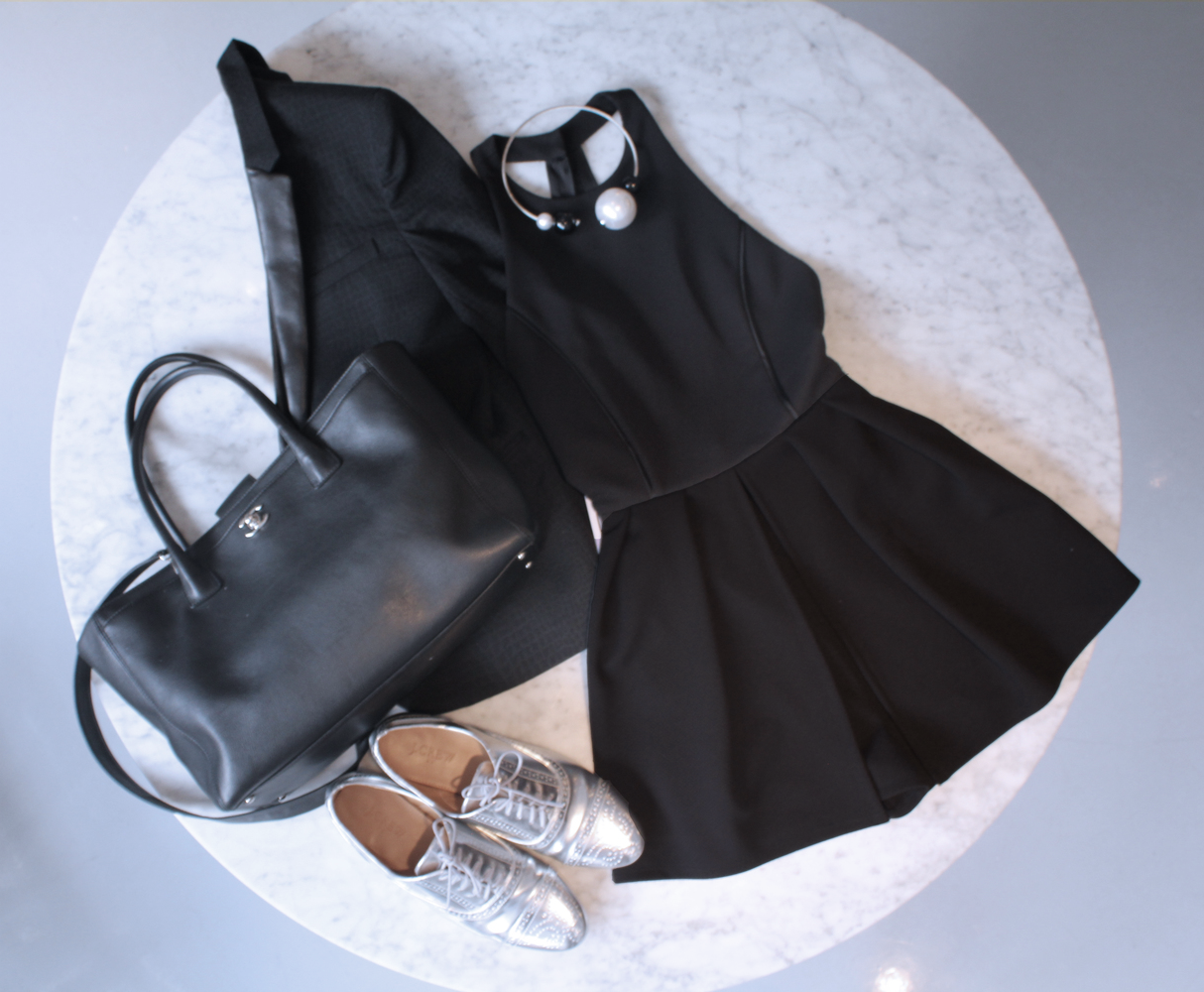 Looking for that romper that fits your work wardrobe? Vanity Room has plenty, this classic black romper paired with a great necklace piece really ties the outfit together. Always make sure you have that outerwear accessory, like this black blazer just in case of those chilly spring breezes.  A cute pair of shoes is a must, and these silver oxfords go perfectly.