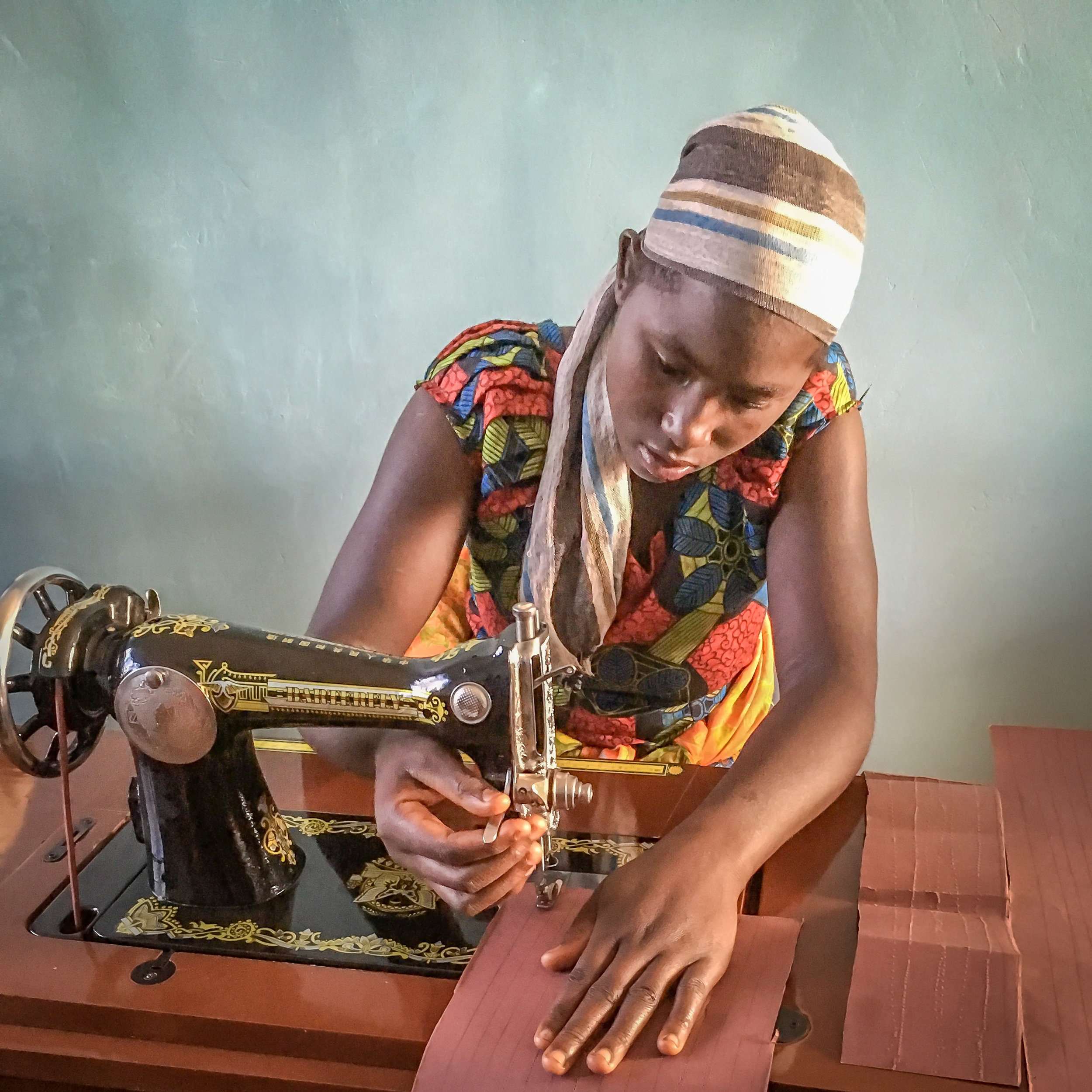 One of the young women perfecting her new sewing skills.