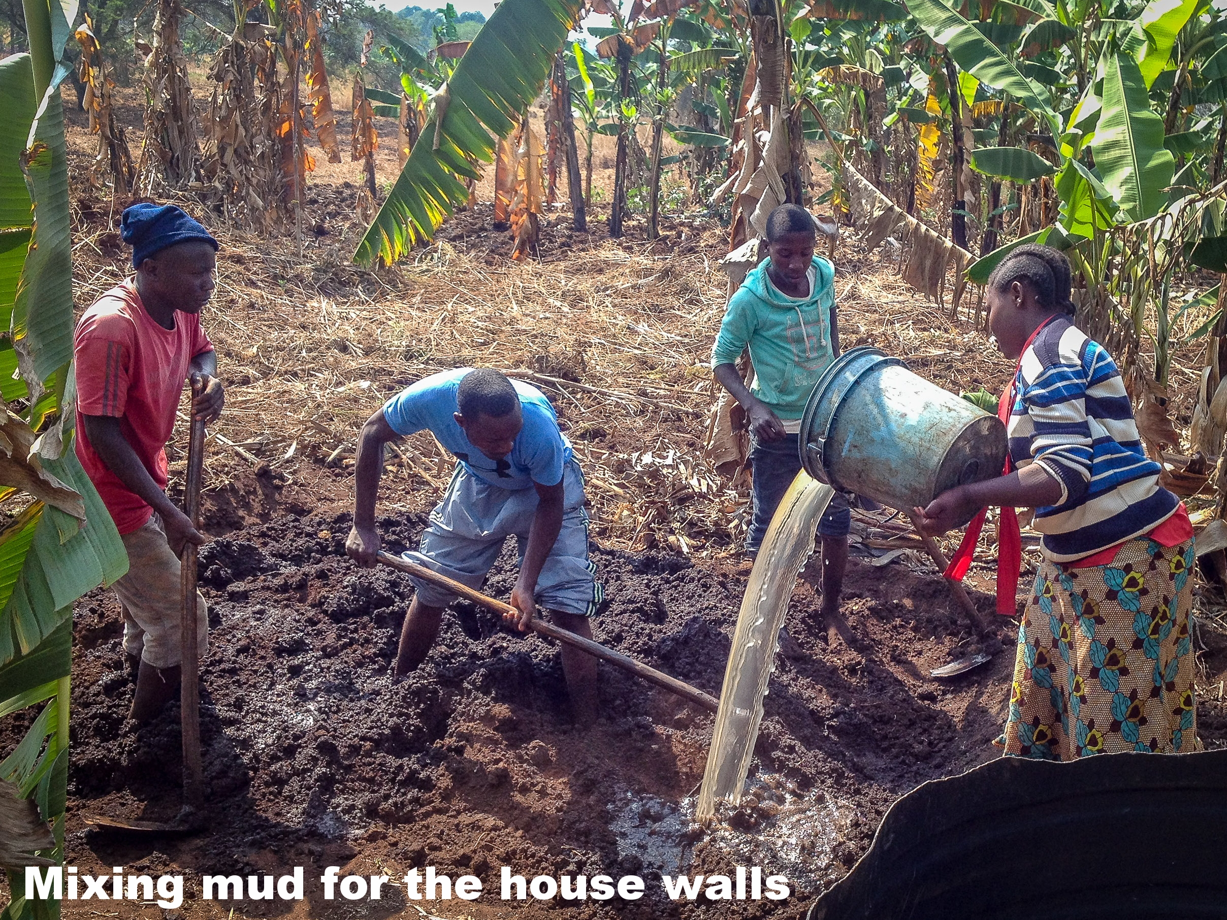 2. Mixing the mud for house walls.jpg