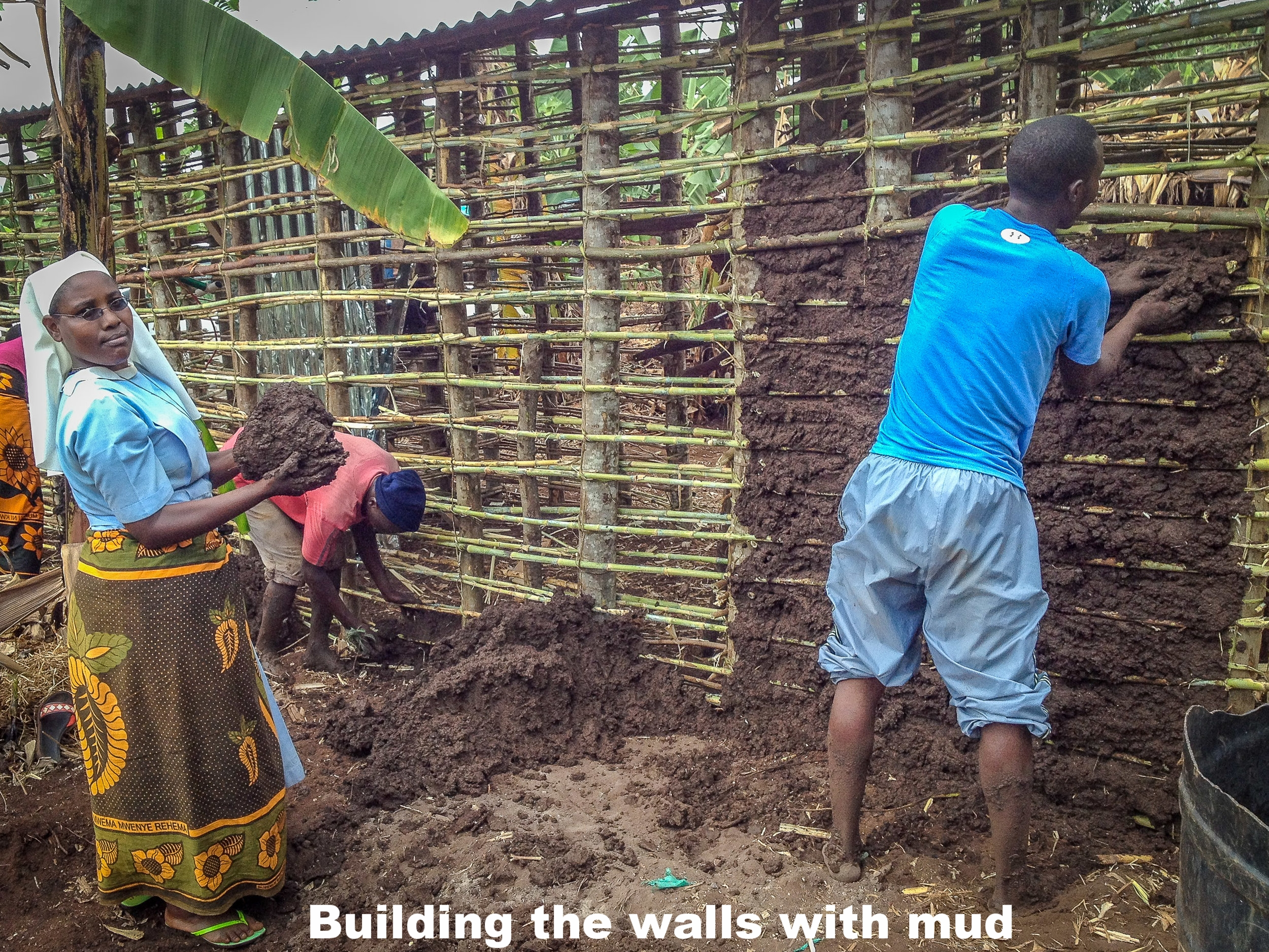 3. Building the walls with moist mud.jpg