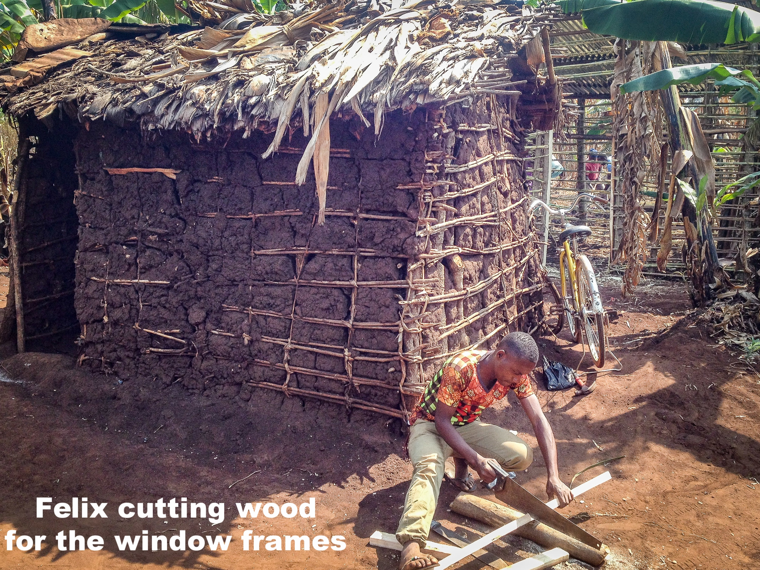 4. Our youth Felix cutting timber for window frames.jpg