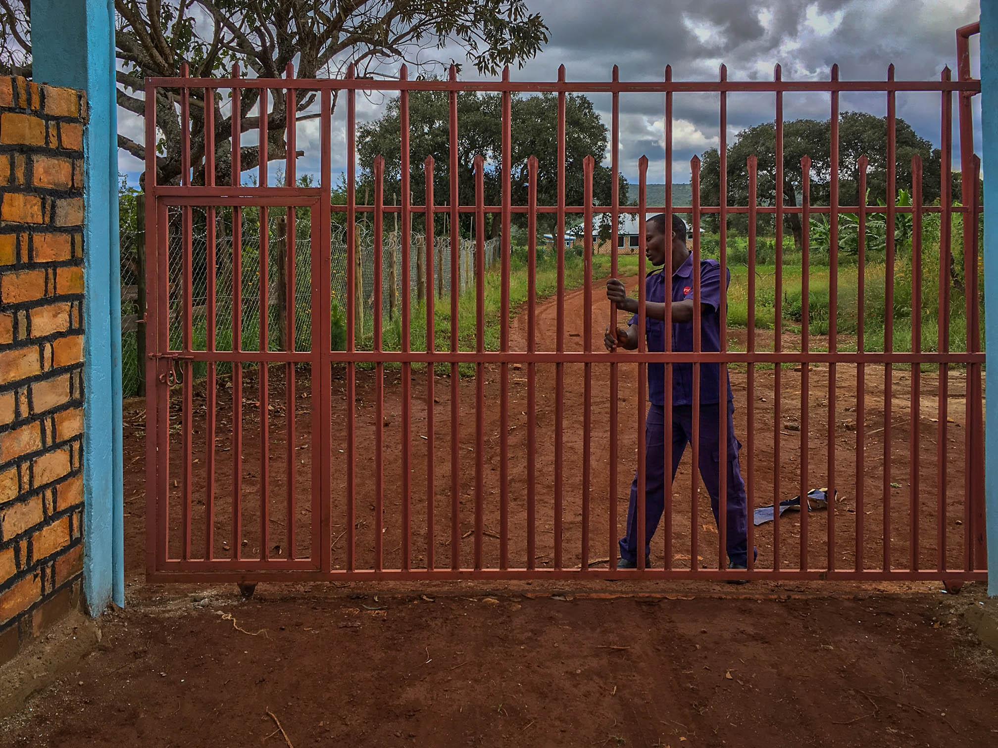 Security guard locking gate.jpg