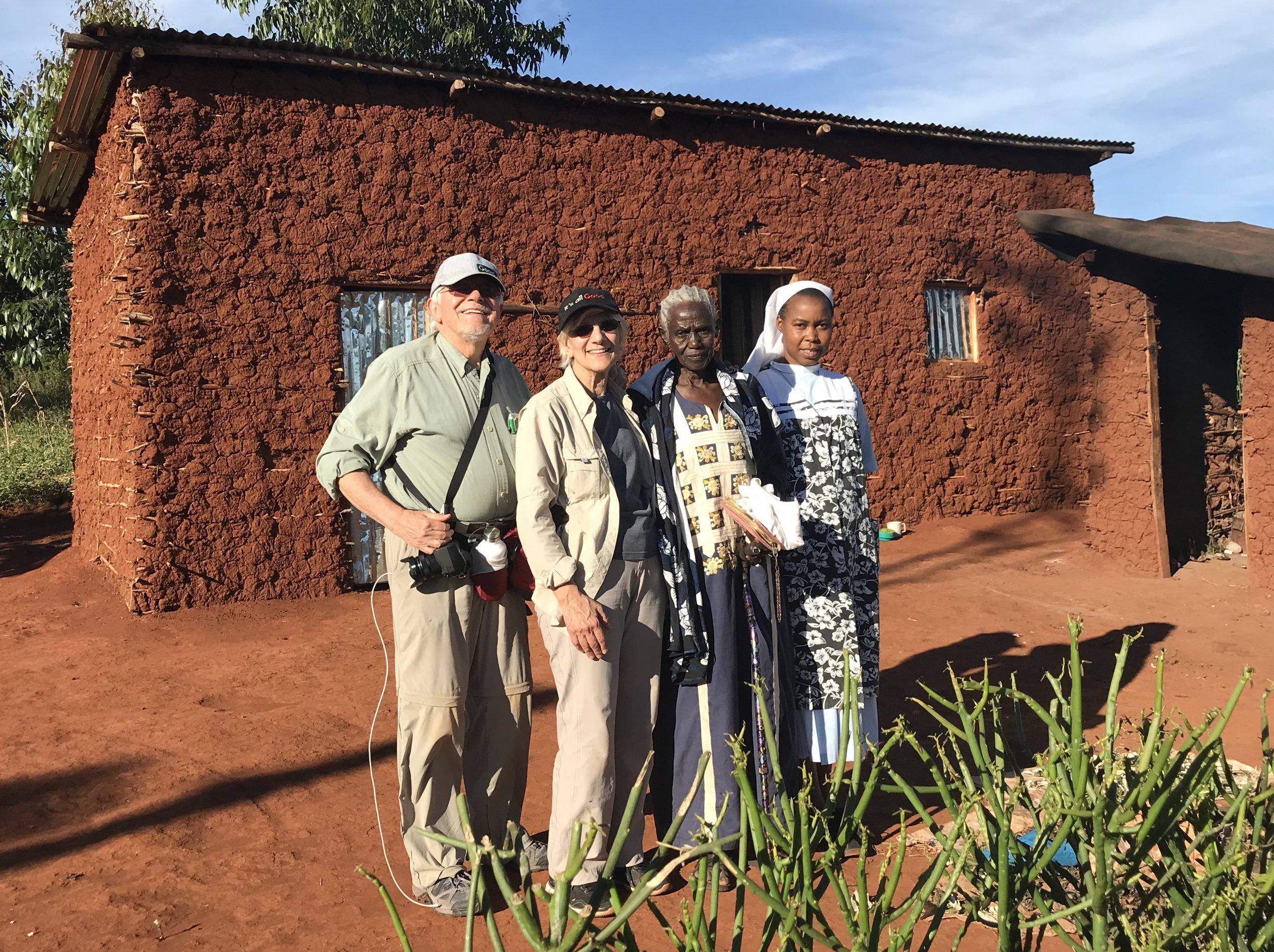 Left to Right: Standing in front of Samia Said's new home are Sergio Burani, Johanna Burani. Samnia Said, and Sr. Dativa Mukebita