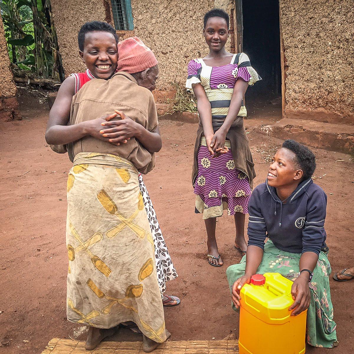 elders happy after receving water.jpg