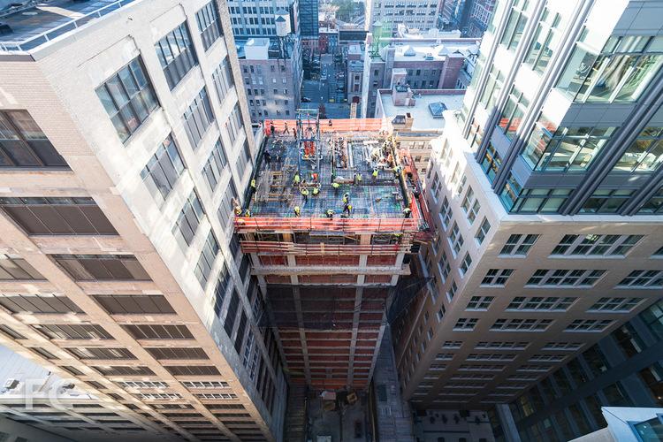 Workers prepare the 15th floor slab of the Vandam Street tower.