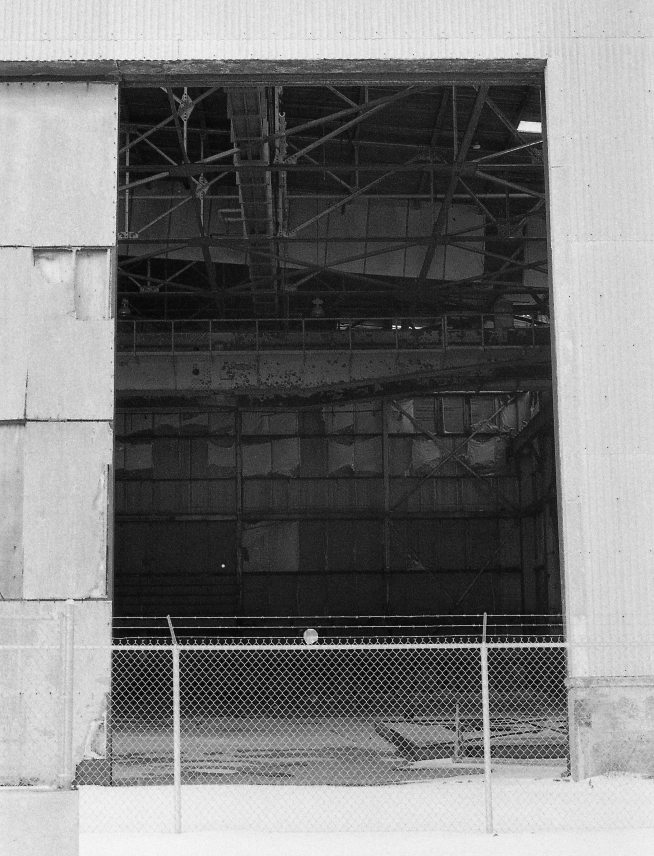 Disused aircraft hanger at the former United States Navy base at Argentia. This massive base constructed during World War II to protect the Atlantic convoys to Great Britain gradually transitioned from a full base with an air field and dockyards to a smaller facility tracking Soviet submarines in the North Atlantic. It closed in 1994.