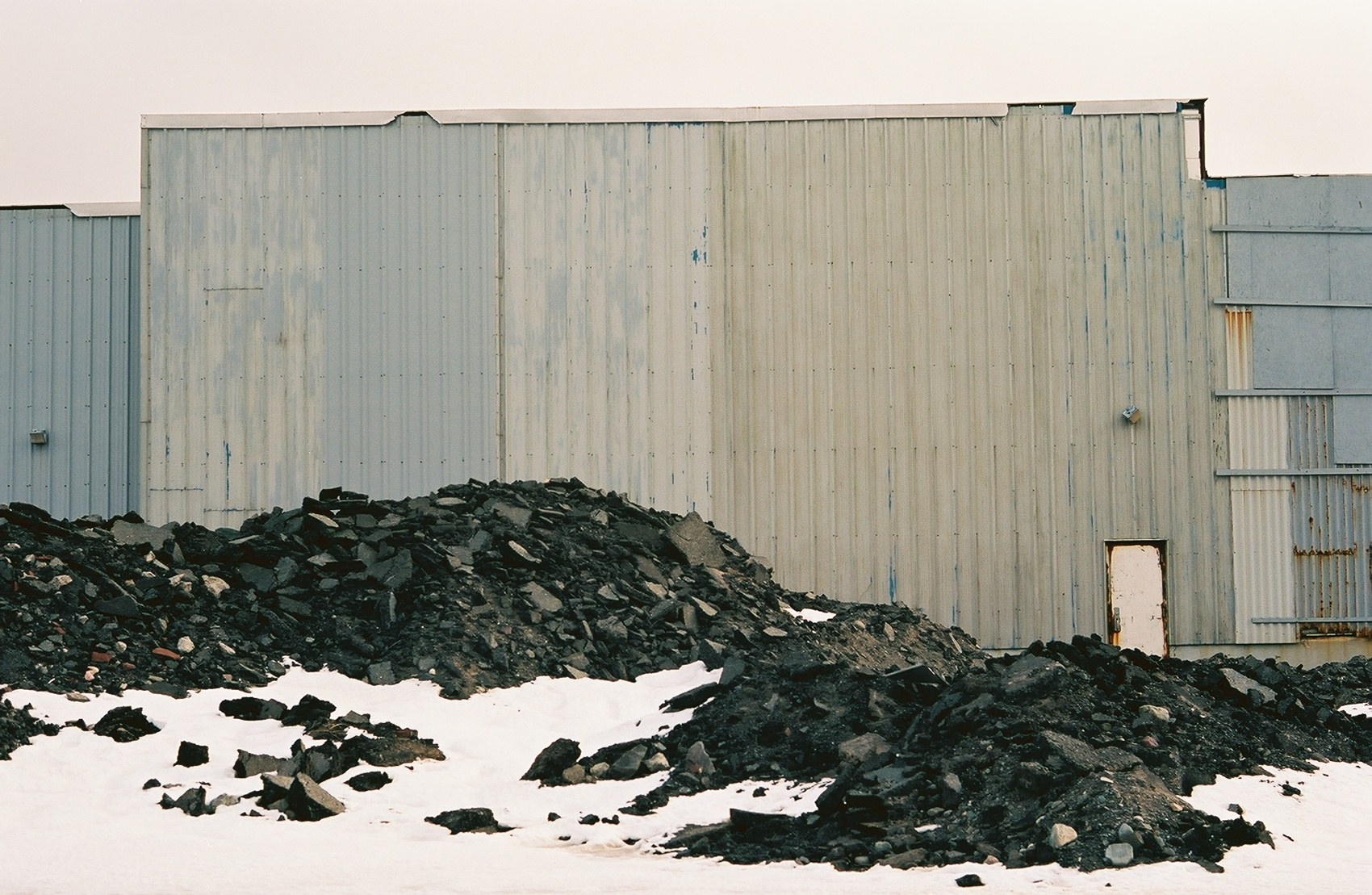 Other buildings slowly crumble. Mounds of excavated soil are also a common site.