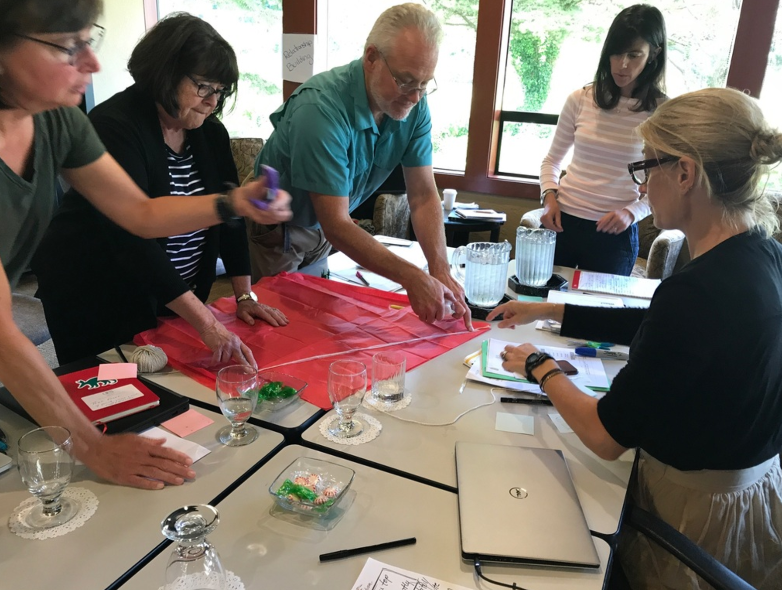 Oregon Episcopal School administrative team designing parachutes during a recent session. Exercises like these help us get in the mindset for innovation and creative risk-taking.