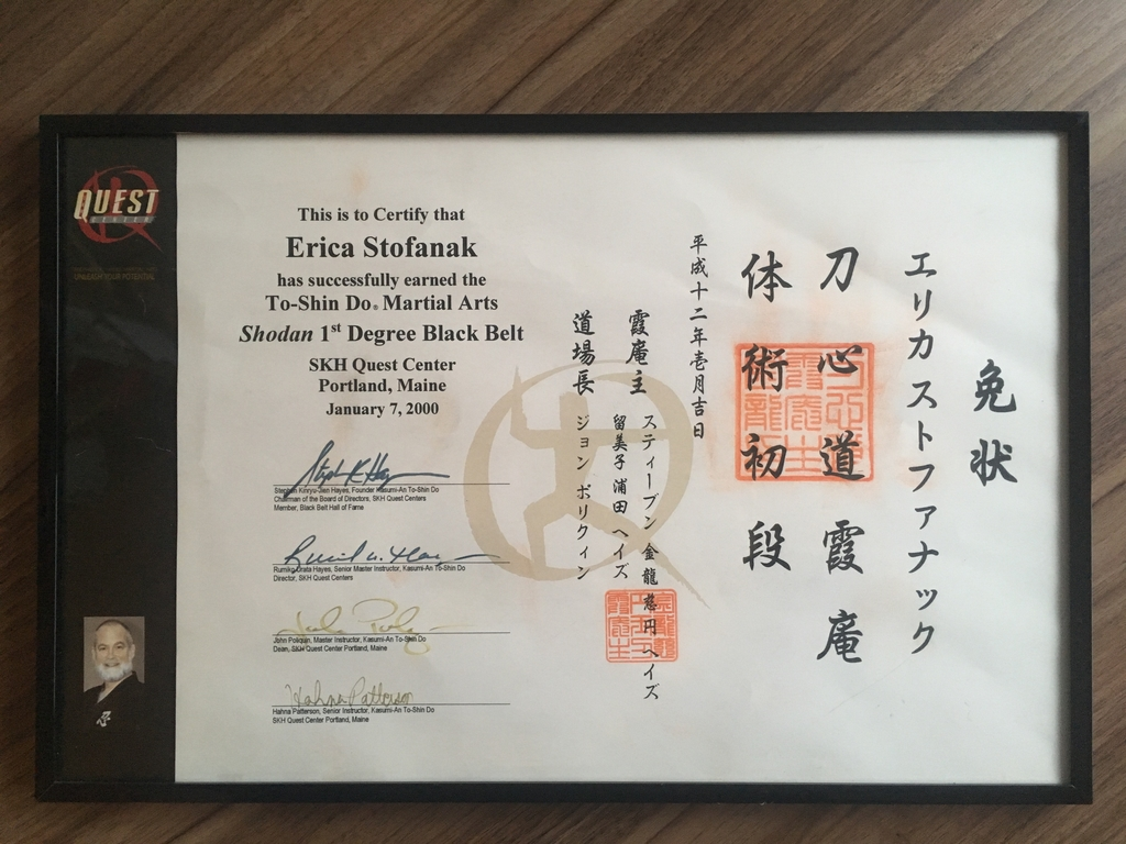 A photo of the author's black belt certificate.