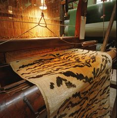 Tiger prints such as this one at  Le Manach  in Tours, France continues to employ the original looms that have been used since the early 19th century to create one of the most beautiful and expensive silk velvet tiger prints in the world.