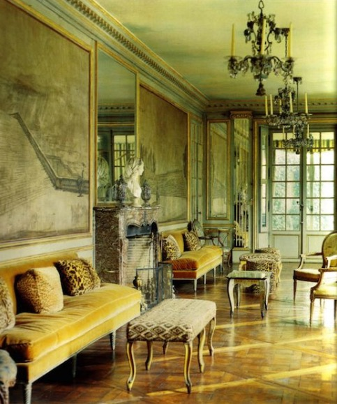 Velvet leopard skin throw pillows on banquets running down a hallway in Elsie De Wolfe's Villa Trianon from 1906 on the Palace Versailles grounds.