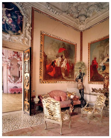 Here is an over-the-top interior using tiger and leopard designed by Tony Duquette for the Rosekran's apartment in the Palazzo Brandolini on the Grand Canal in Venice. Even the seams of the room and framing on the paintings are finished in tiger and leopard.