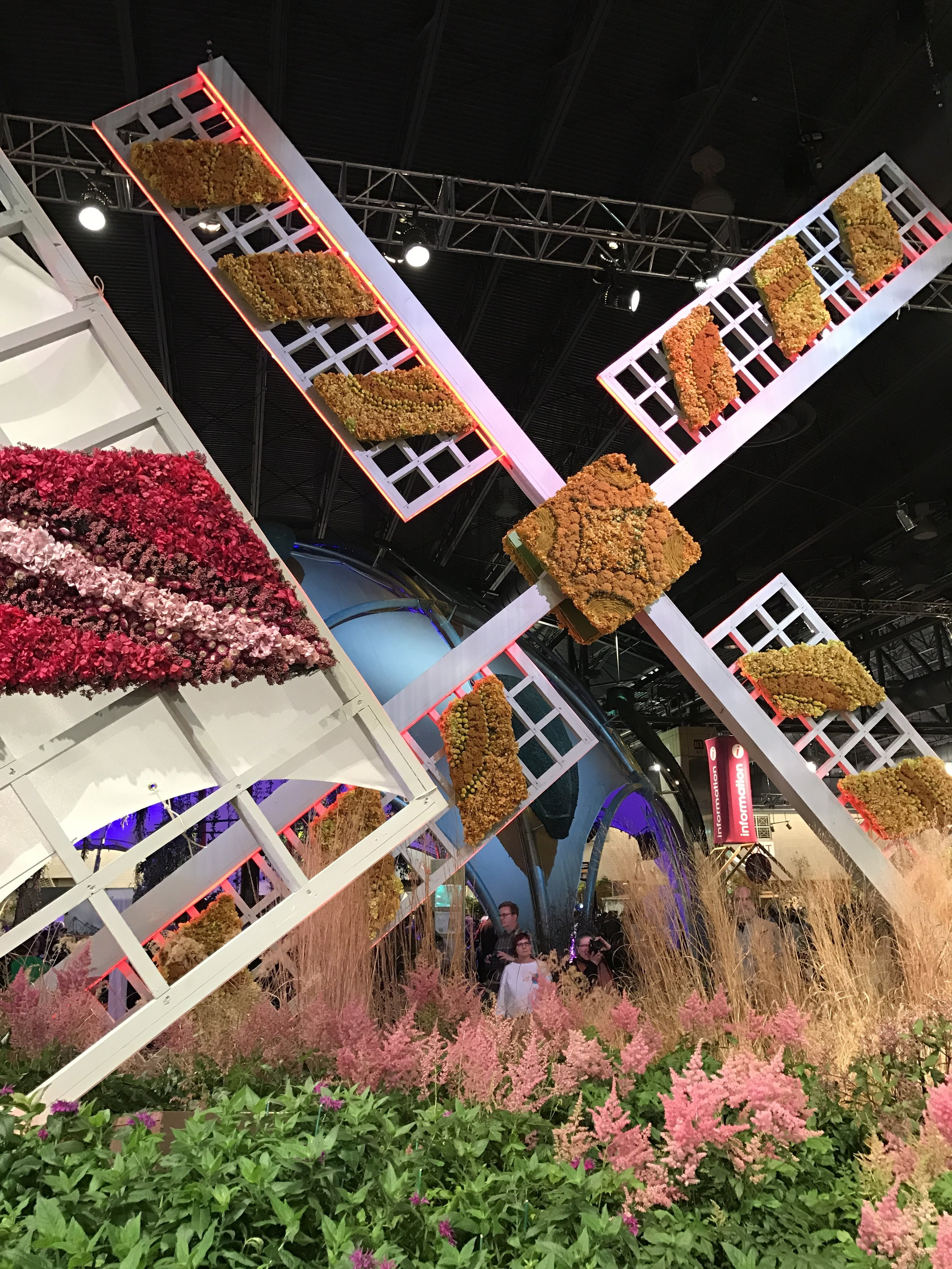 Those are flowers covering the windmill at the 2017 Philadelphia Flower Show, Holland.