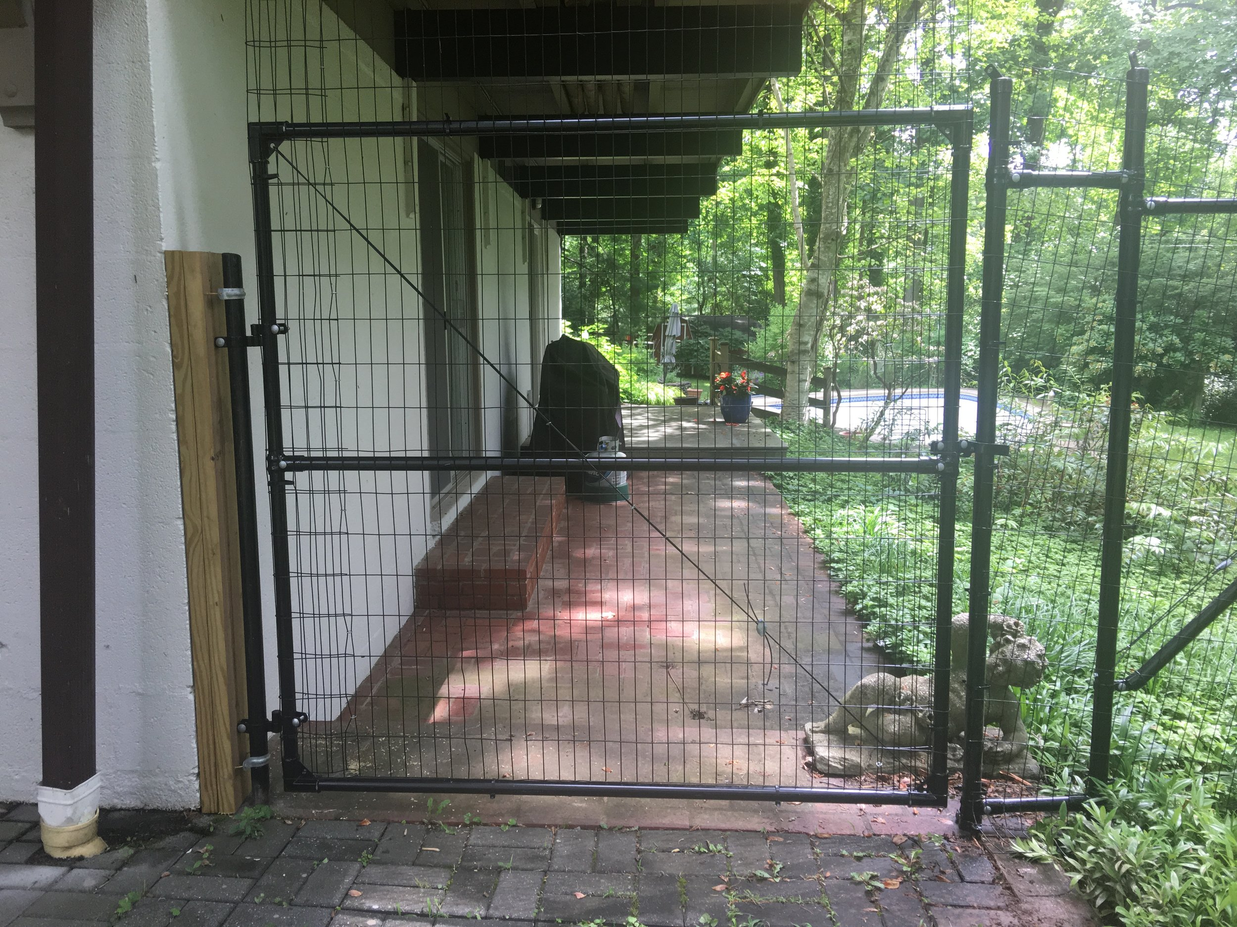 gate-attached-to-house