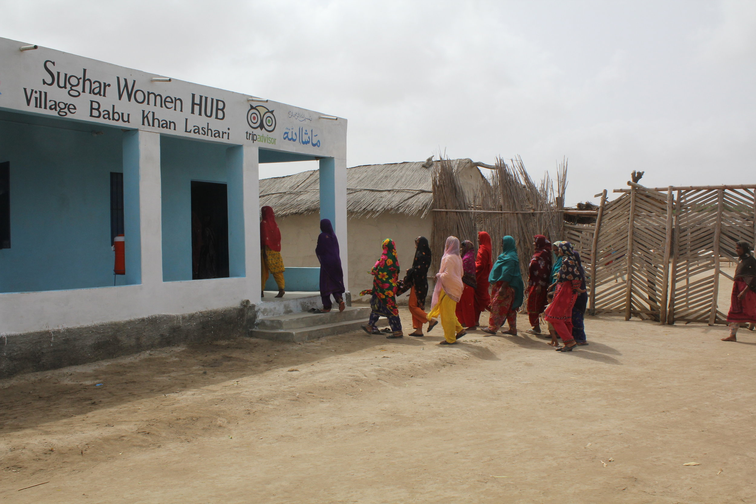 Sughar Hubs established in villages and women going to the Hubs.JPG