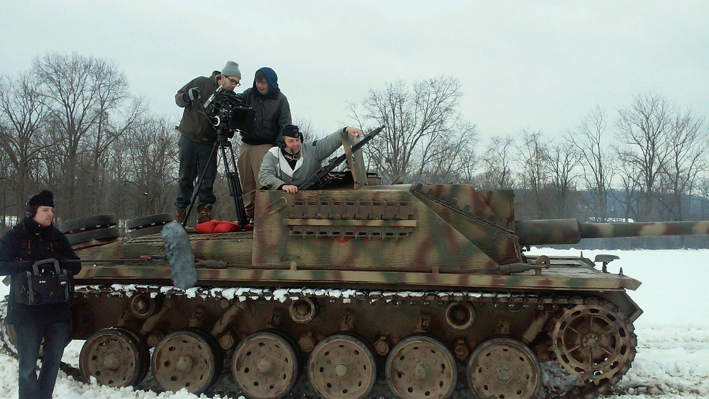 on a tank on the set of Fatal Crossroads