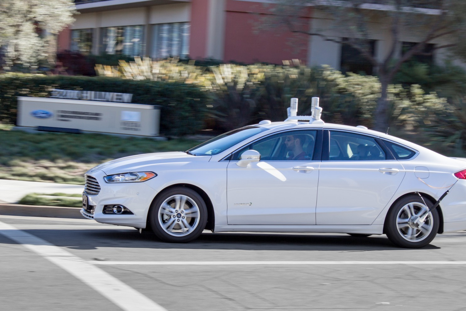 A Ford Fusion, driven by a human, makes a turn outside the company's research and innovation center in Silicon Valley. Ford will test autonomously in the second half of 2016. (Ford)