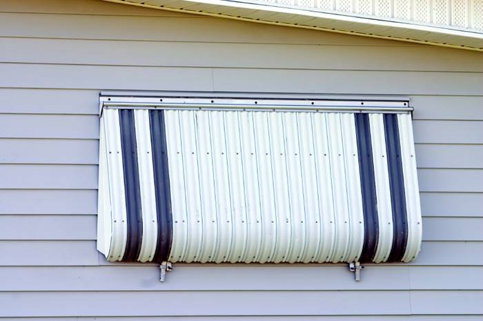 Shutters can protect your windows from heavy winds and flying debrisin storm. (Photo: iStock)