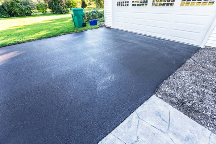 Winter can cause cracks and potholes in a driveway. Sealing is an effective way to correct those problems. (Photo: iStock)