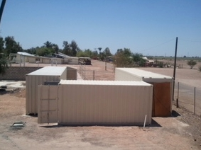 Construction phase of the Mexicali Super Kitchen putting in place the three containers that make up three walls of the facility.