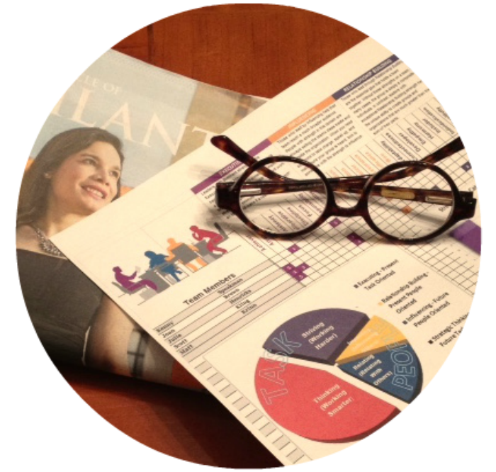 Joan's glasses on top of fundraising research and copy of Chronicle of  Philanthropy