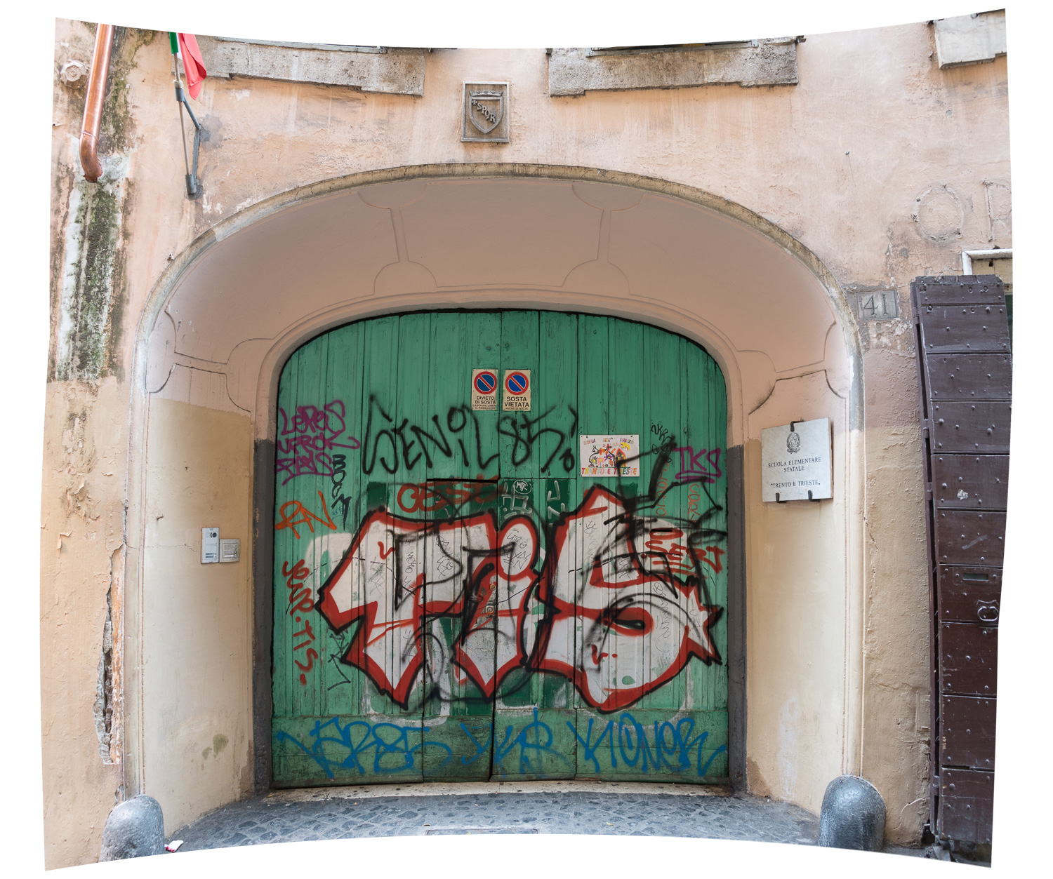 The original graffiti'd school entrance - two photos stitched together in Photoshop