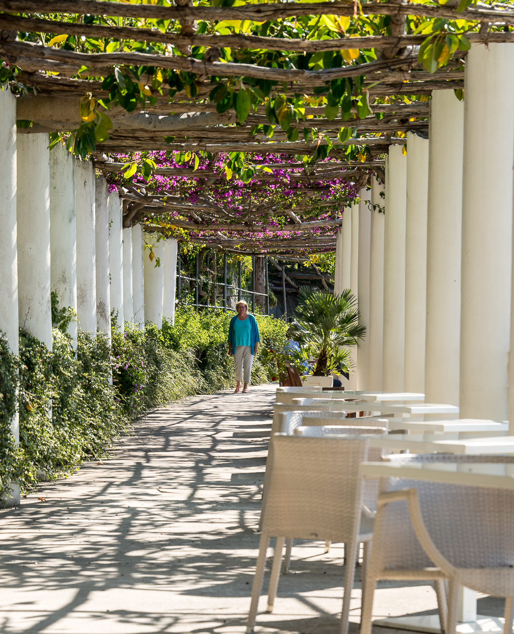 This loggia leads from the dining veranda to the pool
