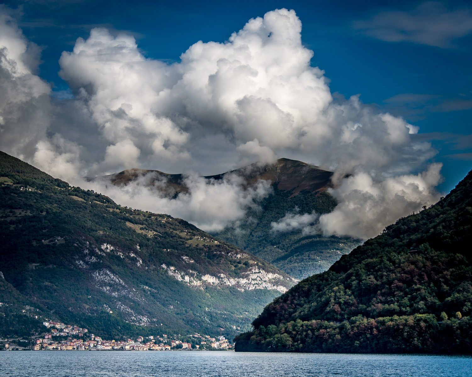 Lago di Como is surrounded by mountains...and the auto road that ends at Bellagio can be seen cutting across the hill on the right