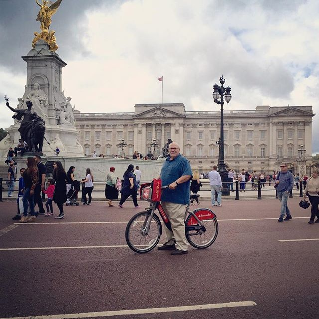 Spending time bike riding past Buckingham Palace in London.