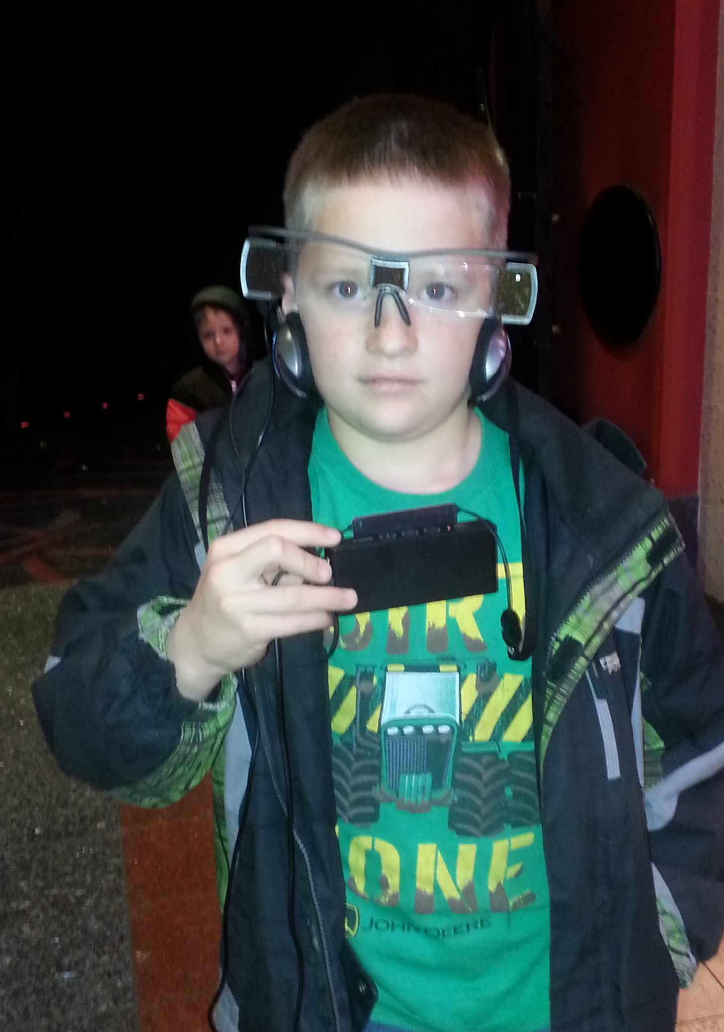 My Nephew modeling the captioning glasses and headphones at Edwards in Idaho Falls after watching Star Wars VII.