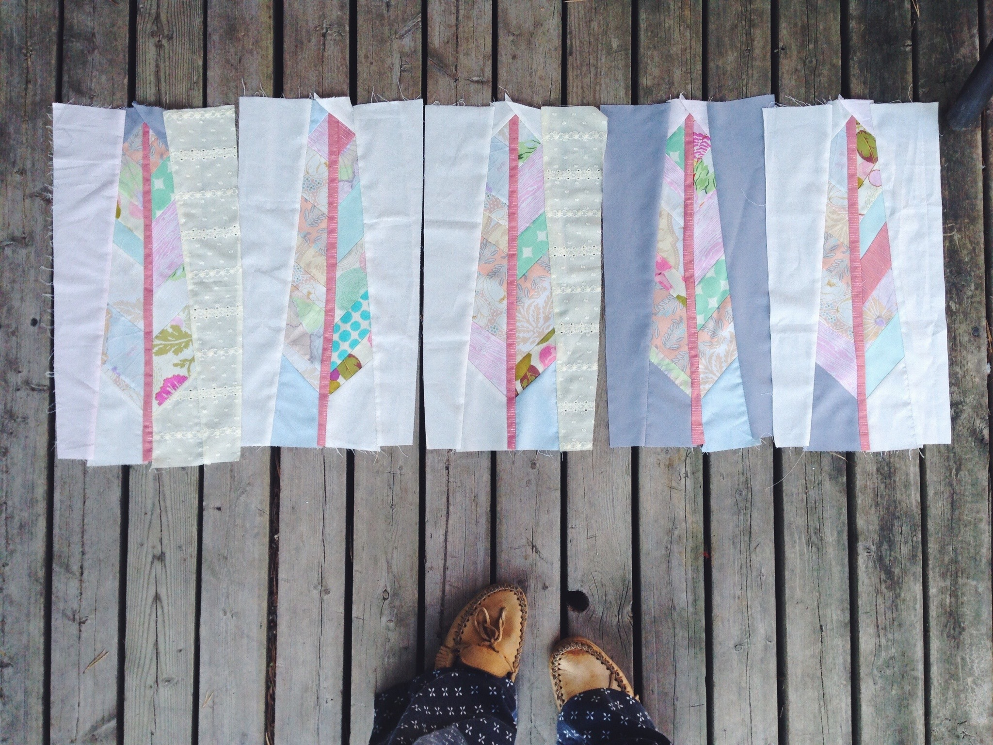 The beginnings of a beautiful featherbed quilt