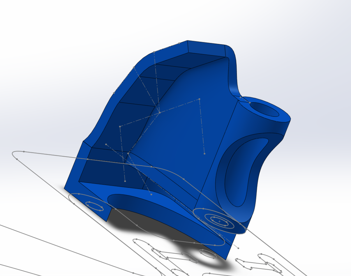 The surface is thickened to make it a solid, and the extra material on the noseguard cut away.