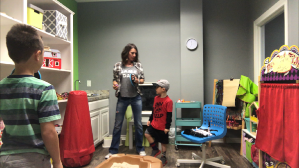 Kelly Martin, MEd, LPC, RPT in a mock group play therapy session. Children pictured are not actual clients.