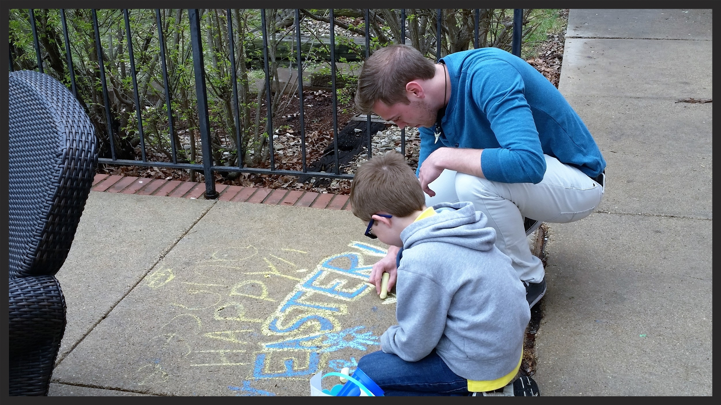 Andrew Nation decorating our patio with a child during our Easter Egg Hunt