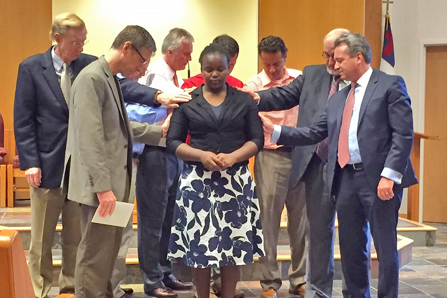 The West County Church's pastor and elders lay hands on Maya as a prayer of dedication is offered. (Photo submitted by Mary Schwantes)