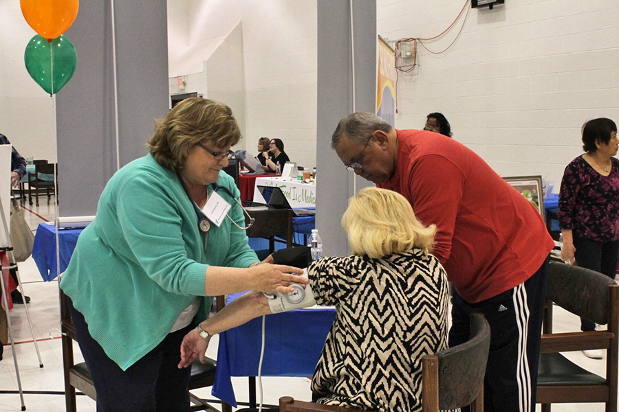 Linda Klevin, RN, provides blood pressure readings to community members attending the West County Church's Health Expo. (Photo submitted by Mary Schwantes)