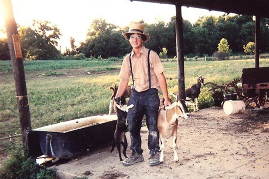Luke Stoltzfus tends goats on the family farm as a teenager.
