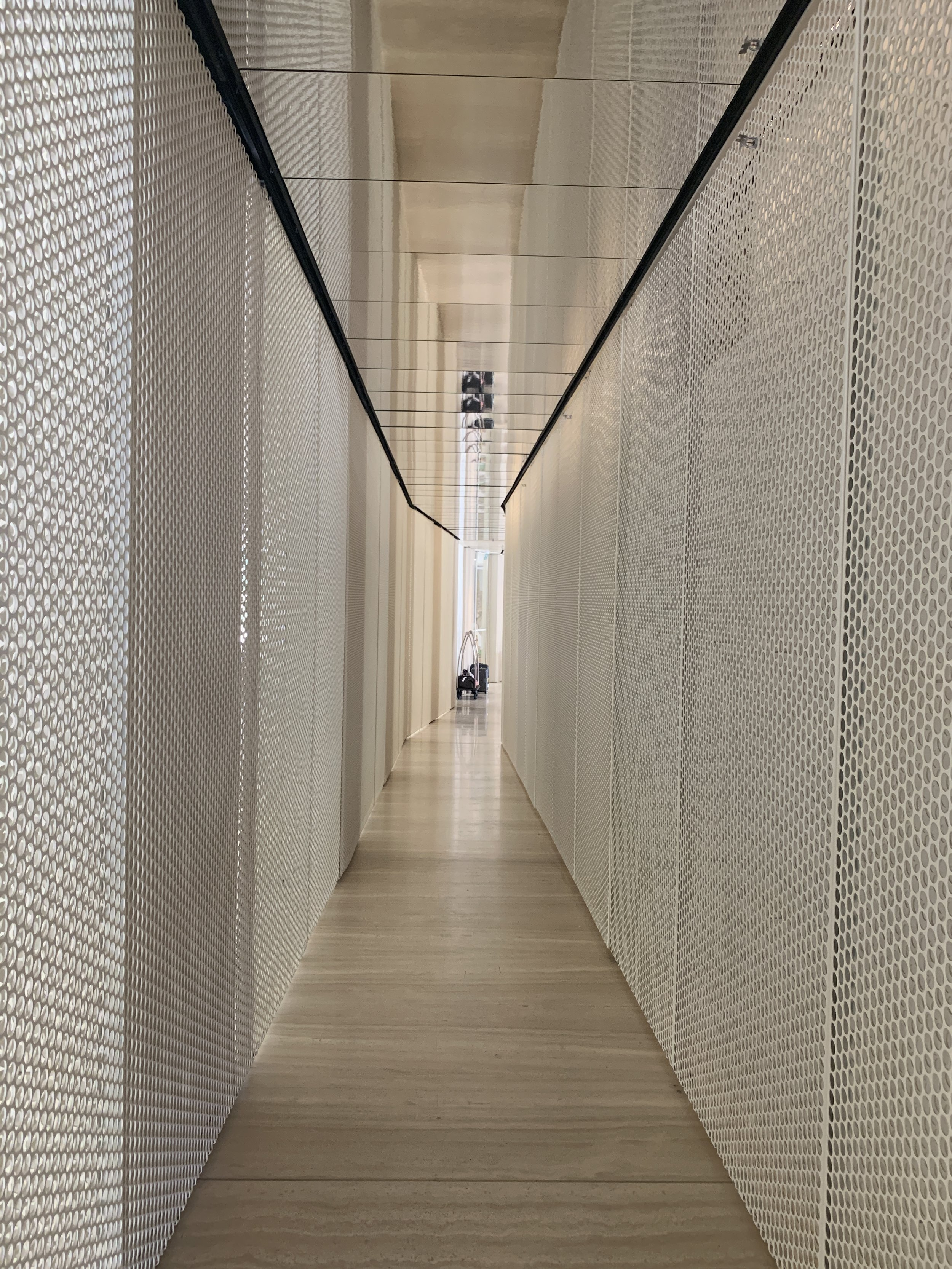 Entry to The Jaffa, layered perforated white powder coated steel layers create a beautiful design motif which weaves it way throughout the entire hotel.