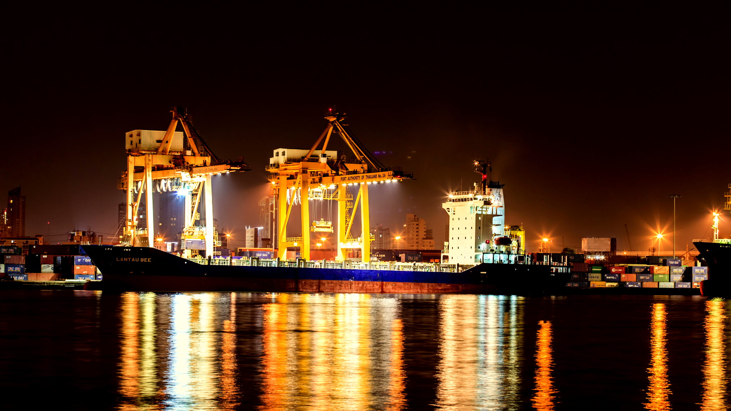 stock-footage--k-timelapse-cargo-ship-loading-goods-at-shipping-port-high-quality-ultra-hd-x.jpg