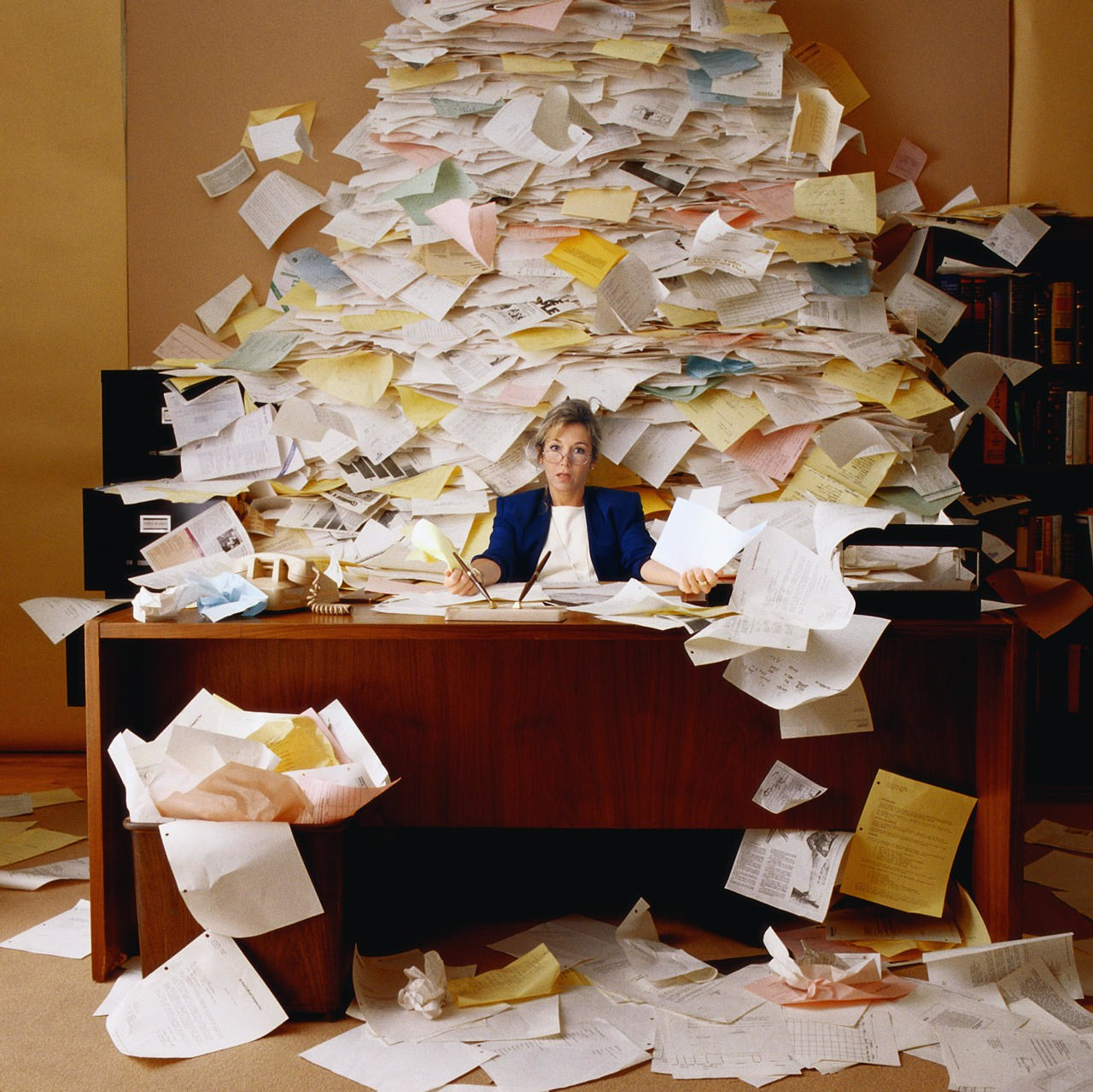 Office Worker with Mountain of Paperwork